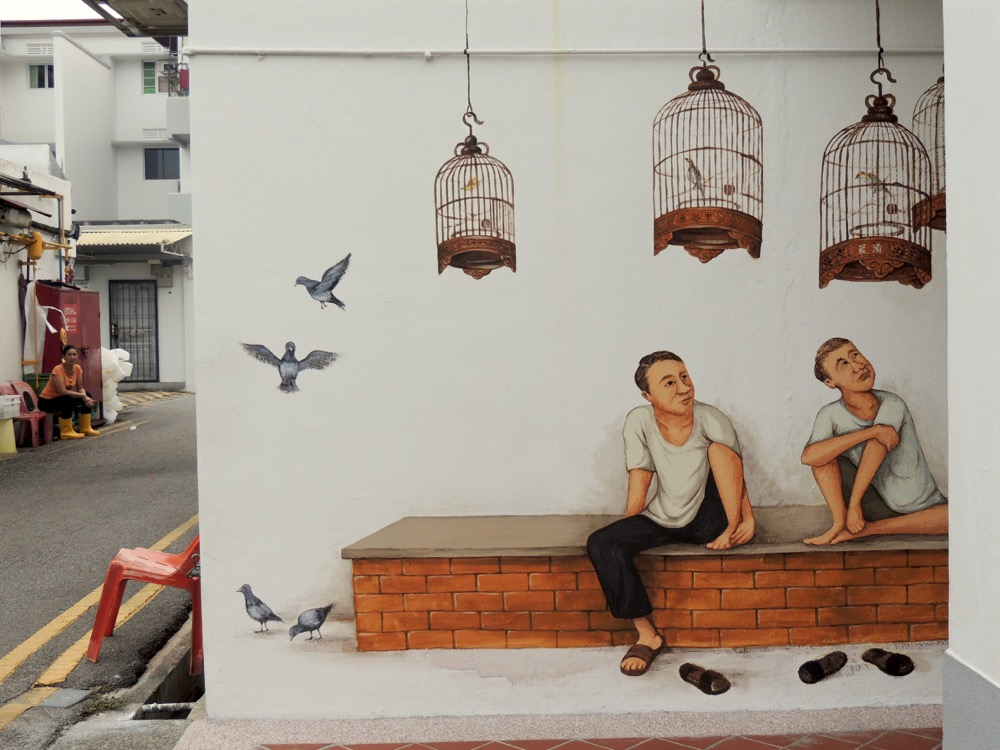 "On the second day of painting ""Bird Corner"", I added 4 fluttering pigeons. The caged birds were jealous!"